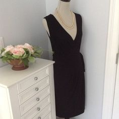 BARNEY'S Wrap-Style Dress Versatile black wrap dress with subtle touching on bottom half. Wraps/ties in several different ways. Lightweight cotton fabric (100% viscose). Great for travel. Dress it up or keep it casual! Barney's Dresses