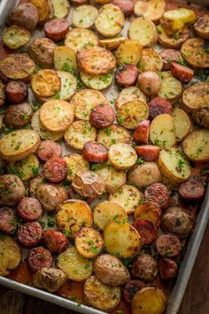 These roasted potatoes are ultra crispy and flavorful with a perfect browning on the coins of kielbasa. Easy, one-pan roasted potatoes and sausage recipe. - I used carrots and parsnips instead of potatoes. This was the best way I've ever eaten kielbasa! Roasted Potatoes And Sausage Recipe, Kielbasa And Potatoes, Sausage And Potatoes Skillet, Sausage And Peppers, Russet Potatoes, Pork Recipes, Cooking Recipes, Healthy Recipes, Delicious Recipes