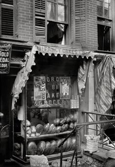 """New York circa 1910, somewhere on the Lower East Side. """"Bread for the poor."""" 5x7 glass negative, George Grantham Bain Collection."""