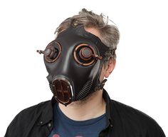 This cast silicone gas mask features jeweler's lenses. All the metal is machined aluminum with an antique copper finish.