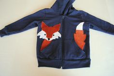 this is adorable, just applique fox head and tail sticking out of hoodie pockets! Or, if you don't sew, you could always buy this one for $36, haha!