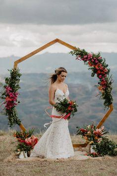 Heptagon arch, hexagon arch, geometric wedding inspiration, tropical elopement, tropical flowers , bride, Adventure Elopement Planner – Christen & Rob – Fiji Highlands - Kama catch me www.kamacatchme.com