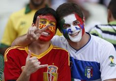 Fans of Spain and Italy gesture before the teams' Confederations Cup semi-final soccer match at the Estadio Castelao in Fortaleza