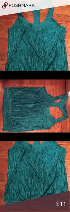Green shirt Great shirt for going out! Only worn twice! Made out of polyester. Feels very silky like. Tops