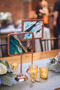 marbled centerpiece idea - photo by Elvira Kalviste Photography http://ruffledblog.com/smoke-and-mirrors-wedding-inspiration