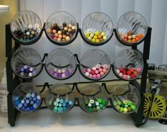 A wine rack filled with basic glasses keeps colored marking pens organized and acts as a decorative element.