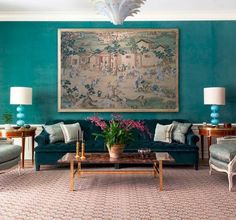 Sumptuous teal on the walls and upholstery in this living room by Markham Roberts. Love the play...