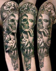 Day of the dead tattoo. Love the rose border and sugar skull qualities of the skull.