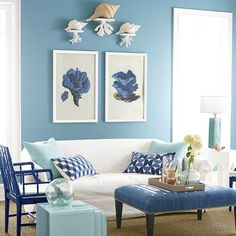Decorative Floating Coral Shelves in a Serene Blue and White Living Room: http://www.completely-coastal.com/2016/02/floating-coastal-coral-shelves.html