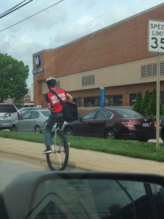This delivery man is riding a unicycle.