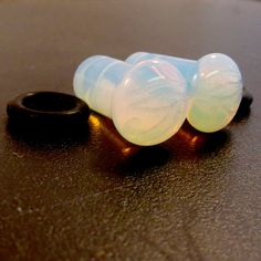 Hey, I found this really awesome Etsy listing at http://www.etsy.com/listing/123374786/eye-of-horus-opalite-single-flare-plugs