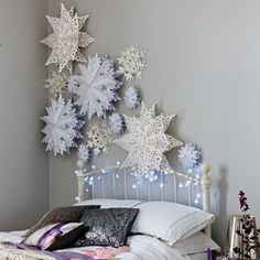 Easy Living Design t        Facebook      Twitter      Google Plus      Pinterest    Winter Wonderland    Cluster oversized paper snowflakes for a beautifully wintry bedroom wall. You could also suspend them from the ceiling.