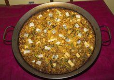 Paella de cebolla, coliflor y ajos tiernos