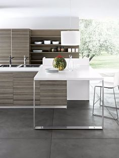 The Ariel Collection offers this stunning lava teak matrix melamine door finish with matte aluminium edges. New Kitchen Designs, Interior Design Kitchen, Ariel, Kitchen Benches, Kitchen Collection, Outdoor Furniture Sets, Modern Design, Kitchen Cabinets, Dining Table