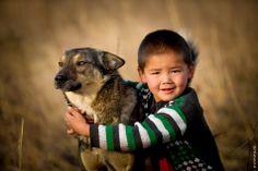 Kazakh boy with his dog