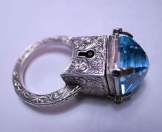 Sterling Silver Poison Ring with a Large Central Topaz