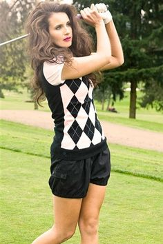 Pink and black argyle sweater vest... haha her hair while she's golfing...really? Why would they do that?