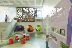 Madison Central Library in Madison WI / MSR. The bright and whimsical children's area evokes an open meadow, with vibrant colors, child-sized fixtures, and reading nooks that light up w...