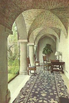 Coco had architect Robert Streitz take inspiration from the Cistercian convent orphanage where she grew up, but on the vaulted brick ceilings you would also find the crown from the Duke of Westmister's coat of arms.