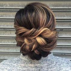 softly swept plaited bun bridal hair