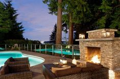 Fireplace next to the pool offers a wonderful focal point for the outdoor lounge