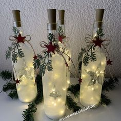 dekoration Lichterglanz With a few empty wine bottles, a couple of LED fairy lights and Empty Wine Bottles, Painted Wine Bottles, Lighted Wine Bottles, Bottle Lights, Wine Bottle Lighting, Vintage Bottles, Vintage Perfume, Decorating With Christmas Lights, Christmas Decorations