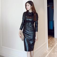 Asian girl in black leather dress