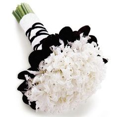 I like how it's wrapped and the idea of black underneath the arrangement but I am not crazy about the flower choice.