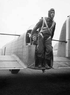 A parachute soldier demonstrates the exit point from the tail of a Whitley bomber converted to parachute-dropping, RAF Ringway, January 1941.