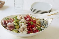 No-Cook Cobb Salad | Giada De Laurentiis | With both marinated chickpeas and shredded rotisserie chicken, this is a lot more substantial than your run-of-the-mill Cobb. Prosciutto or its smoked cousin, speck, stands in for bacon so you don't need to turn on the stove, but if it's not a Cobb without bacon for you, feel free to substitute.