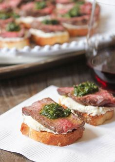 Beef Tenderloin Crostini with Whipped Goat Cheese and Pesto = perfect to pass at your Oscars party!
