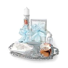 Babys Baptism Candle Gift Set Style SB3321-BOY- In Choice of Language Set includes cross shaped candle, new testament, clear rosary, shell, handkerchief, holy water bottle and silver tray. Each set comes in a gift box.  http://www.flowergirldressforless.com/mm5/merchant.mvc?Screen=PROD&Product_Code=AG_SB3321-BOY&Store_Code=Flower-Girl&Category_Code=New