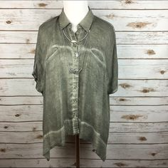"""[Free People] Boho Military Button Down Top Hippie Lightweight and breezy button down shirt. Short dolman sleeves. 2 welt chest pockets. Falls longer on the sides. Cool over dyed finish to fabric. Very soft. Looks great with cutoffs and boyfriend jeans. Oversized fit. Could probably work for a small also.  Fabric: 100% Rayon  Bust: 28"""" Length: 24"""" Condition: EUC. No flaws.  No Trades! Free People Tops Blouses"""