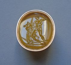Intaglio; sard; Theseus killing the Minotaur; monster with human body and bull's head forced onto left knee; Theseus, pressing his left knee against its right thigh, seizes it by the horns and swings club over its head; in gold ring with inscription..