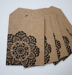 Brown paper tags with black doily stamp