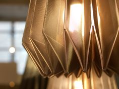 Foldability is pioneering high-tech metalised fabrics for origami lighting products that are more durable than their paper counterparts