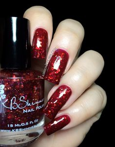 KBShimmer ● Fall In Love ●Leaf of Faith    Leaf Of Faith is a red jelly with different sizes of red, orange and gold glitters as well as a touch of holographic pieces. You'd think that there can only be so many red glitters and yet we have another beauty. I used 2 coats plus topocat below but depending on your application, you might need a third one or prefer to wear it over a red crelly. Fashion Polish: KBShimmer Fall In Love collection swatches and review!