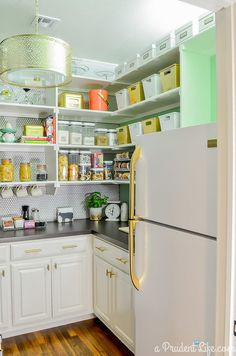 When you're looking to give your kitchen an update without breaking the bank, there's a plethora of easy projects that can totally refresh your space. Use a variety of jars, tins, and vases to make a pantry so gorgeous that you will want to keep the doors open.