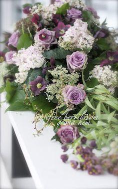 Funeral arrangement in purple tones