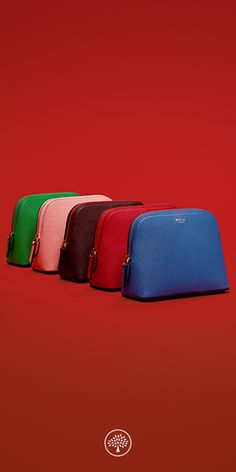 Keep all of your essentials close to hand with our collection of Mulberry classic cosmetic pouches and wash cases.