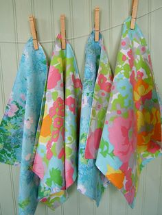 love these Vintage floral napkins on clothesline...maybe alternate floral napkins with pictures from her first year