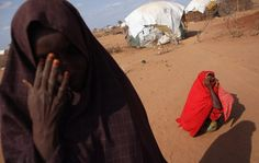 Somalian refugees rest outside their homes on the edge of the Dagahaley refugee camp which makes up part of the giant Dadaab refugee settlement on July 21, 2011 in Dadaab, Kenya. The refugee camp at Dadaab, located close to the Kenyan border with Somalia, was originally designed in the early 1990s to accommodate 90 000.  Image by: Oli Scarff / Getty Images