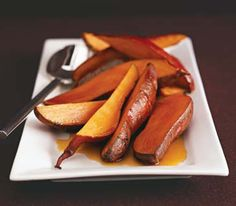 Vanilla Sweet Potatoes | Baked sweet potatoes are drizzled with a fusion of maple syrup, vanilla beans, and cloves.