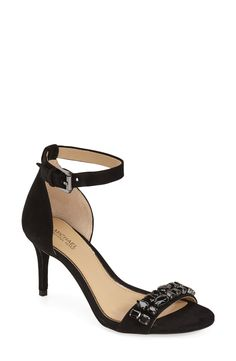 Faceted crystals sparkle and shimmer on the strap of this lofty evening sandal to provide a scene-stealing flourish.