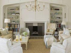 ivory and white neutral living room, bookshelf styling, jute rug