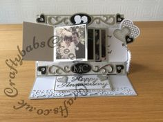 Waterfall Silver wedding card made using printed, hand cut waterfall mechanism, photographs and mats and layers, dies used include quickutz silhouettes, Cheery Lynn and Spellbinders nesting hearts, Leanne creative flourishes and Spellbinders sapphire alphabet dies.