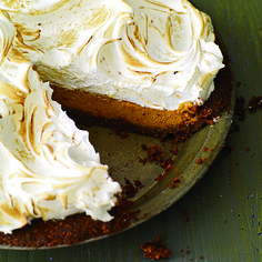 Sweet-Potato Meringue Pie | This dish looks like a pumpkin pie, but the filling is actually made with sweet potato.