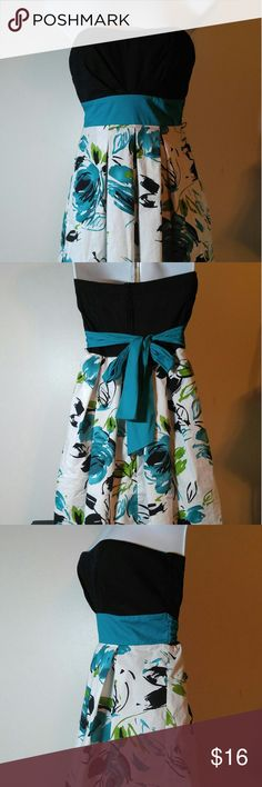 Adorable Strapless Spring Dress Sz 3 Juniors Strapless Spring Dress-Like New!- Length is 25 inches from the bust line to the Hem. Pretty Aqua and Black with built in bra. Trixxi Dresses