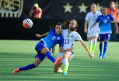 Alex Morgan and Thaisa of Brazil, Oct. 25, 2015. (Sam Greenwood/Getty Images North America)