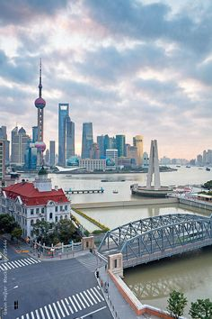 New Pudong skyline; Waibaidu (Garden) Bridge; looking across the Huangpu River from the Bund; Shanghai; China by Gavin Hellier